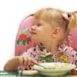 Stock Photo: Little girl blonde eats