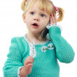 The little girl the blonde with phone — Stock Photo #2474501