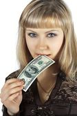 Beautiful woman bites hundred dollar — Stock Photo
