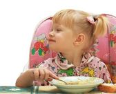 Little girl the blonde eats — Stock Photo