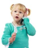 The little girl the blonde with phone — Stock Photo