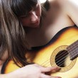 Girl plays an acoustic guitar — Stock Photo