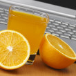 Royalty-Free Stock Photo: Oranges, juice and laptop.