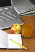 Orange juice,laptop,apple and notepad. — Stock Photo