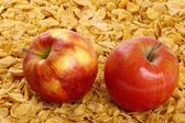 Apple and cornflakes — Stock Photo