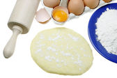 Eggs,dough and rolling pin — Stock Photo