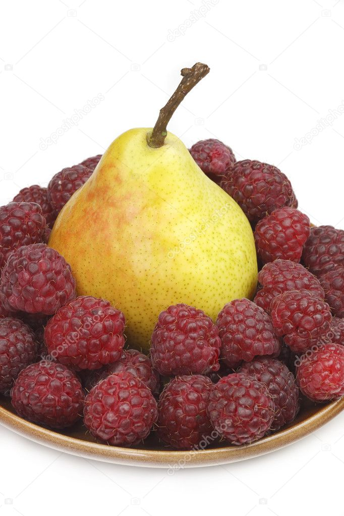 Pear and raspberries — Stock Photo #1639979
