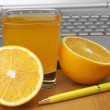 Stock Photo: Oranges, juice and laptop.