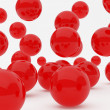 Red balls falling — Stock Photo