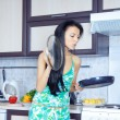 Housewife and frying pan — Stock Photo
