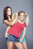 Blond and brunette — Stock Photo