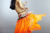 Backside of the belly dancer — Stock Photo
