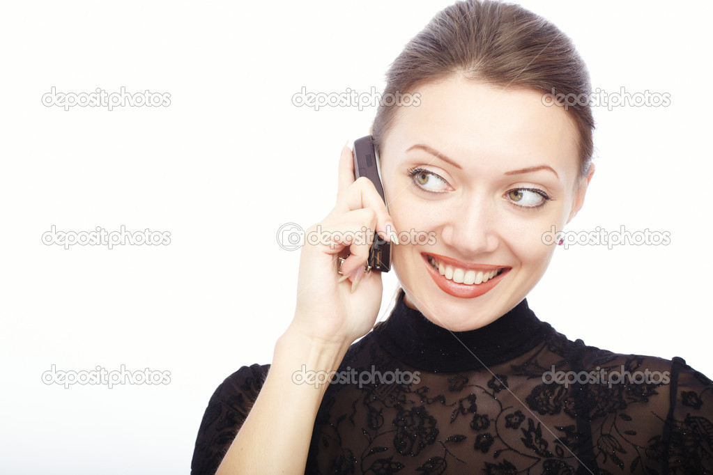 Glad smiling lady on a white background talking via cellphone  Stock Photo #1626688