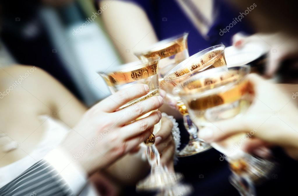 Close-up photo of human hands clangin wineglasses and celebrating event — Stock Photo #1628111