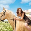 Escaping on a horseback - Stock Photo