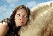 Portrait of the woman on a horse back — Stock Photo