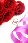Ribbon and wedding rings with flowers — Stock Photo