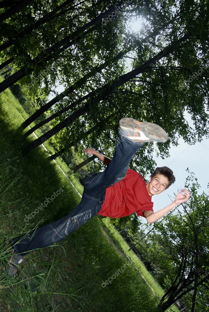 Outdoors photo of the cheerful boy doing karate kick — Stock Photo #1771603