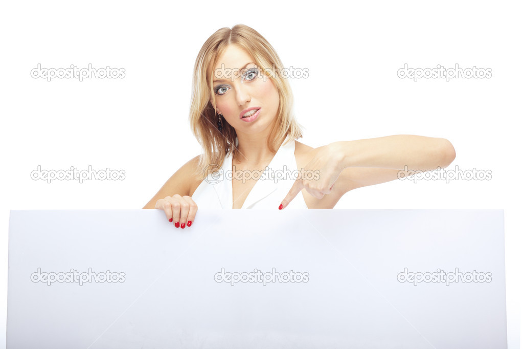 Businesslady on a white background pointing to the billboard by her finger — Stock Photo #1774383