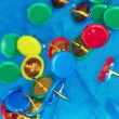 Wet pushpins on a blur background - Stock Photo