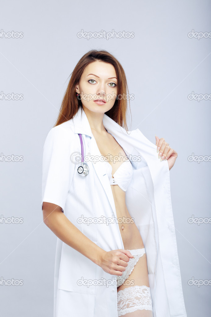 Sexy female doctor revealing medical uniform with stethoscope — Stock Photo #2537534