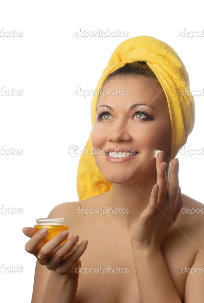 Smiling model with anti-wrinkle cream after shower — Stock Photo #2681302