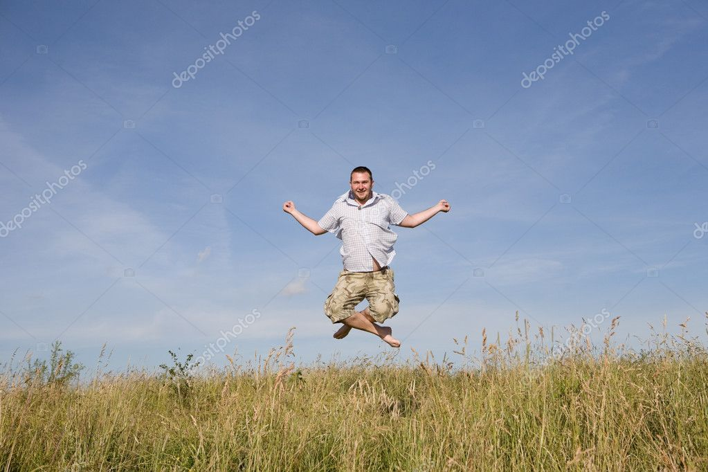 Happy man relaxing on meadow — Stock Photo #1639973