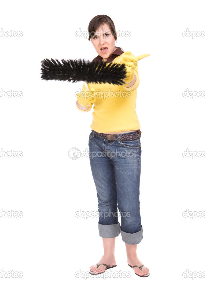 Attractive brunette woman doing housework, over white background — Stock Photo #1665676
