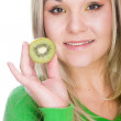Blonde with kiwi — Stock Photo