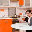 Businesswoman in kitchen - Stock Photo