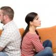 Angry couple sitting on sofa — Stock Photo