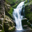 Waterfall in mountain - Stock Photo