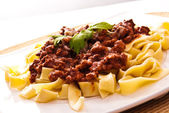Spaghetti bolognese with cheese — Stock Photo