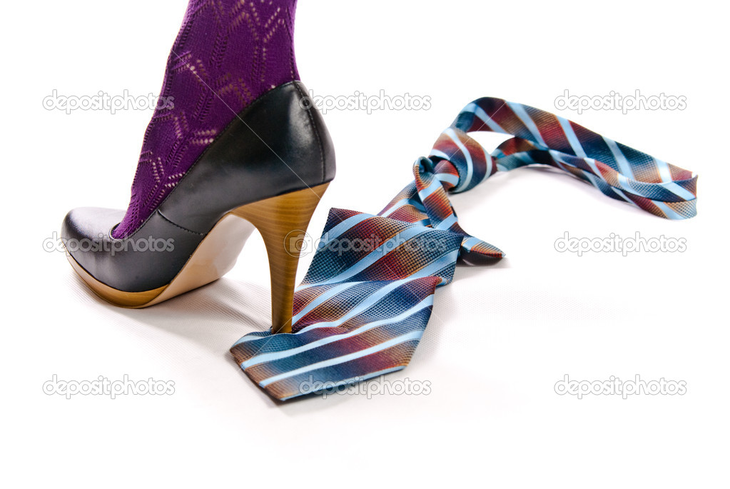Woman's shoe on high heel tread colorful tie — Stock Photo #1617914