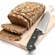 Wholemeal bread on kitchen board — Stock Photo