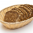 Wholemeal bread in wicker basket — Stock Photo