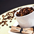 Coffee cup and beans with brown sugar — Stock Photo