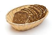 Wholemeal bread in wicker basket — Stock Photo