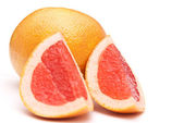 Red grapefruit and parts of it — Stock Photo