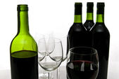 Bottles of red wine and wineglasses — Stock Photo