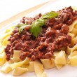 Spaghetti bolognese with cheese - Stock Photo