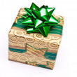 Christmas present with green bow — Stock Photo