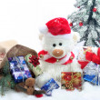 Teddy with a lot of Christmas presents - Stock Photo