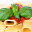 Pasta with tomato sauce and basil — Stock Photo