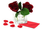 Letter with red roses and red hearts — Stock Photo