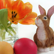 Stock Photo: Easter bunny with eggs and tulips