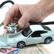 Stock Photo: Stethoscope with car and money