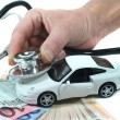 Stethoscope with car and money - Stock Photo