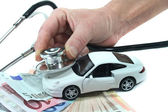 Stethoscope with car and money — Stock Photo