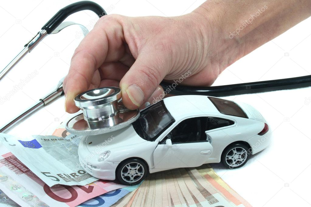 Stethoscope with car and euro notes on a white background — Stock Photo #2366077